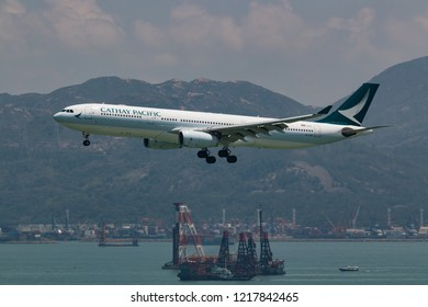 Hong Kong, China. June 28, 2018. Cathay Pacific Airbus A330-300 Reg. B-LAC on Short Final Approaching for Landing at Hong Kong Chek Lap Kok International Airport.