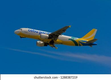 Hong Kong, China. June 29, 2018. Cebu Pacific Airbus A320-214 Reg. RP-C3264 Taking Off from Hong Kong Chek Lap Kok International Airport with Blue Sky.