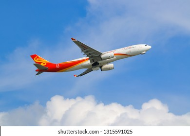 Hong Kong, China. June 29, 2018. Hong Kong Airlines Airbus A330-343 Reg. B-LNS Taking Off from Hong Kong Chek Lap Kok International Airport with Beautiful Cloud Blue Sky.