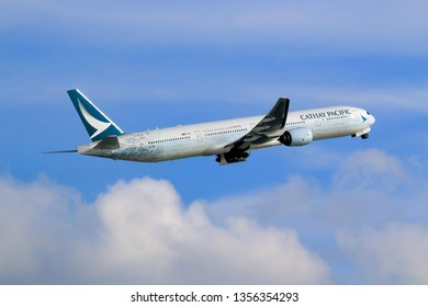 Hong Kong, China. June 29, 2018. Cathay Pacific Boeing 777-367 Reg. B-HNK Taking Off from Hong Kong Chek Lap Kok International Airport with Blue Sky.