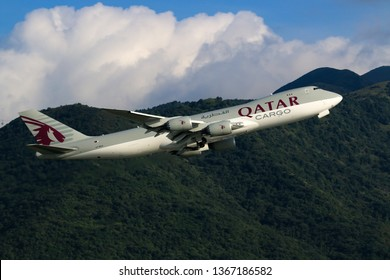 Hong Kong, China. June 29, 2018. Qatar Airways Cargo Boeing 747-87UF Reg. A7-BGA Taking Off from Hong Kong Chek Lap Kok International Airport with Mountain and Blue Sky.