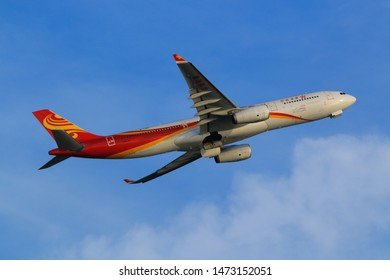 Hong Kong, China. June 29, 2018. Hong Kong Airlines Airbus A330-343  Reg. B-LNU Taking Off from Hong Kong Chek Lap Kok International Airport with Blue Sky.