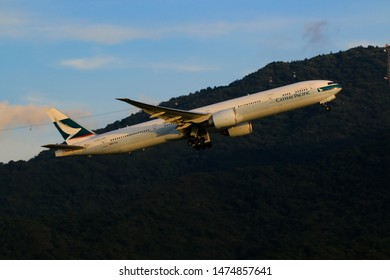 Hong Kong, China. June 29, 2018. Cathay Pacific Boeing 777-367(ER) Reg. B-KQJ Taking Off from Hong Kong Chek Lap Kok International Airport with Blue Sky and Ngong Ping 360 Background.