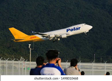 Hong Kong, China. June 29, 2018. Polar Air Cargo Boeing 747-46NF Reg. N451PA Taking Off from Hong Kong Chek Lap Kok International Airport with Mountain Background and Plane Spotters foreground.
