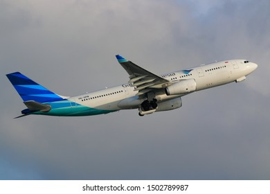 Hong Kong, China. June 29, 2018. Garuda Indonesia Airbus A330-243 Reg. PK-GPN Taking Off from Hong Kong Chek Lap Kok International Airport with Blue Sky.