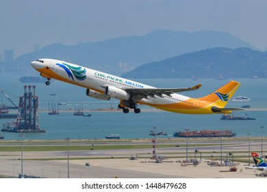Hong Kong, China. June 30, 2018. Cebu Pacific (Philippines) Airbus A330-300 Reg.RP-C3343 Taking Off from Hong Kong Chek Lap Kok International Airport with Sea Reclamation Background.