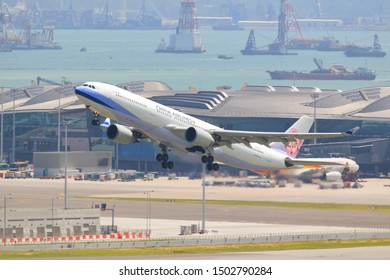 Hong Kong, China. June 30, 2018. China Airlines Airbus A330-300 Reg.B-18307 Taking Off from Hong Kong Chek Lap Kok International Airport with Gate Terminal and Sea Reclamation Background.