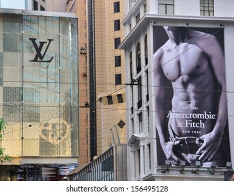 HONG KONG, CHINA - JUNE 5: The facades of flagship stores of Louis Vuitton and Abercrombie and Fitch in Causeway bay at night on June 5, 2012. Causeway bay is the most expensive street of Hong Kong.