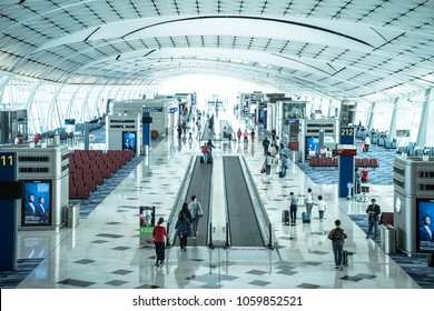 Hong Kong, China - March 19, 2018: Movement of business, passenger and traveler walking in the main terminal for boarding time in Hong Kong International Airport for travel.