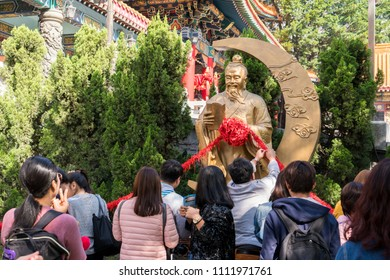 Hong Kong, China - March 19, 2018: Yue Lao Statue with group tourist at Wong Tai Sin Temple in Hong Kong, China. Wong Tai Sin or Huang Daxian is a Chinese Taoist deity popular in Hong Kong.