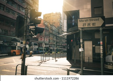 Hong Kong, China - March 19, 2018: Morning in Hong Kong on holiday at Marsh Street with tourist bus waiting for traffice light.