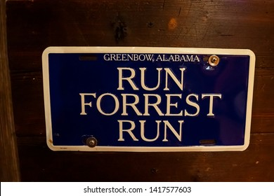 Hong Kong, China, March 2013 Run Forrest Run, Greenbow, Alabama written on dark blue plate on wooden background, famous quotation from movie