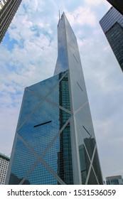 Hong Kong, China - March 23, 2013: Detail view on Bank of China Hongkong Tower at day between surrounded Skyscrapers. Tall Skyscraper on Hong Kong Island