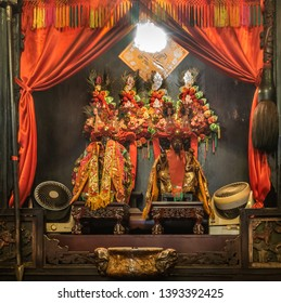 Hong Kong, China - March 8, 2019: Man Mo Yi Tai Taoist Temple in Fu Shin Street. The two leading idols, Man Tai and Mo tai, God of War and of Literature draped in reds and gold, under flowers.