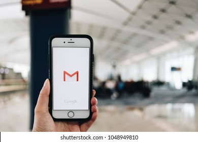 Hong kong, China - March18, 2018: hand holding screen short of Gmail app showing on iPhone6s. Gmail is free e-mail service provided by google.  at Hong Kong International Airport