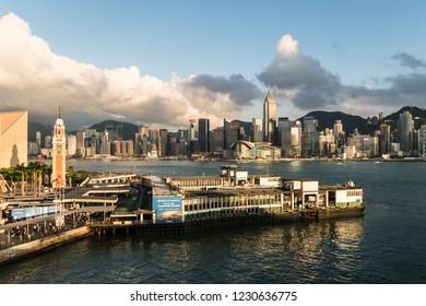 Hong Kong, China - May 15 2018: Aerial view of the Star Ferry terminal in Tsim Sha Tsui waterfront in Kowloon with Hong Kong island skyline.