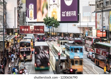 Hong Kong, China - May 16 2018: Tramway cars and buses rush in the crowded street of the famous Causeway Bay shopping district in Hong Kong island business district.