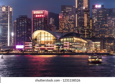 Hong Kong, China - May 17 2018: Star ferry crossing the Victoria harbour with the Hong Kong island skyline in the background with the Hong Kong Convention and Exhibition Centre at Wanchai