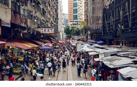 HONG KONG, CHINA - MAY 22, 2014: People shopping at Street market on May 22, 2014 in Hong Kong
