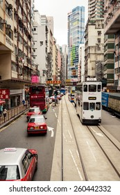 HONG KONG, CHINA - MAY 22, 2014: City trams with double deckers and city buildings on may 22, 2014 in Hong Kong