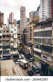 HONG KONG, CHINA - MAY 22, 2014: Typical Hong Kong street with urban buildings, road and traffic on May 22, 2014