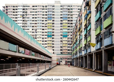 HONG KONG, CHINA - MAY 22, 2014: View on colorful apartment buildings and court with palms on May 22, 2014 in Hong Kong