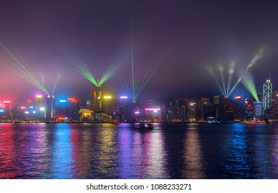 HONG KONG, CHINA - MAY 5, 2018:  Hong Kong skyline at night from across Victoria Harbor, Symphony of lights from Tsim sha tsui, Hong Kong,