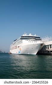 HONG KONG, CHINA - NOV 20: Big Cruise Ship berth at Victoria Harbor on Nov 20, 2014 in Hong Kong, Hongkong is a major tourist city in Asia,More than 40000000 visitors a year.