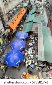 HONG KONG, CHINA - NOVEMBER 19, 2015: A lot of people walking and dining on the Stanley Street in Central on Hong Kong Island in Hong Kong, China, viewed from above.