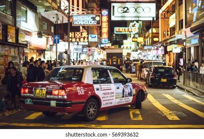 HONG KONG, CHINA - NOVEMBER 22, 2016: A taxi car parked under in the streets of Hong Kong