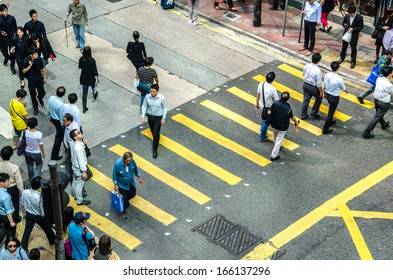 HONG KONG, CHINA - OCT 22: Crowded street view on October 22, 2013 in Hong Kong, China. With 7M population and land mass of 1104 sq km, it is one of the most dense areas in the world.