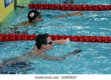 Hong Kong, China - Oct 29, 2016. English competitive swimmer Benjamin PROUD (GBR) and SHIOURA Shinri (JPN) in the finish. FINA Swimming World Cup, Preliminary Heats, Victoria Park Swimming Pool.