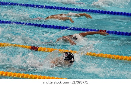 Hong Kong, China - Oct 29, 2016. SAVARD Katerine (CAN), Katinka HOSSZU (HUN) and WORRELL Kelsi (USA) swimming in the Women's Butterfly 100m Final. FINA Swimming World Cup, Victoria Park Swimming Pool.