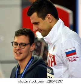 Hong Kong, China - Oct 29, 2016.Mitchell LARKIN (AUS) and the winner DONETC Stanislav (RUS) at the Victory Ceremony of Men's Backstroke 100m. FINA Swimming World Cup, Victoria Park Swimming Pool.