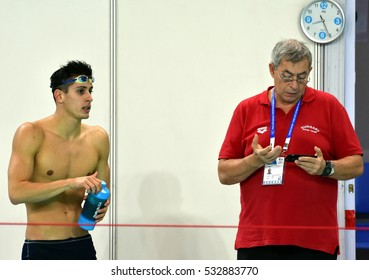 Hong Kong, China - Oct 29, 2016. Gergely GYURTA (HUN) with his coach Ferenc KOVACSHEGYI (HUN) after the Men's Individual Medley 400m Final. FINA Swimming World Cup, Victoria Park Swimming Pool.