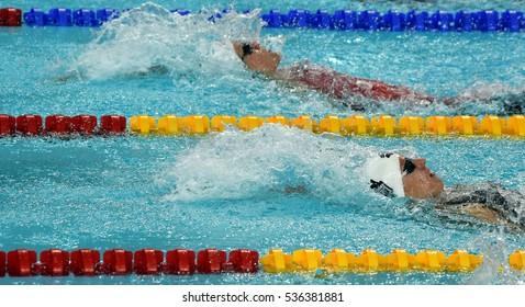 Hong Kong, China - Oct 30, 2016. Katinka HOSSZU (HUN) and HANUS Danielle (CAN) swimming in the Women's Backstroke 100m Preliminary Heat. FINA Swimming World Cup, Victoria Park Swimming Pool.