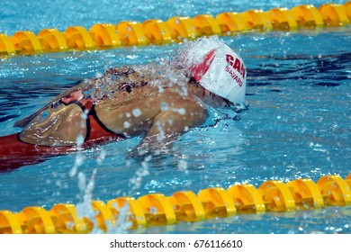 Hong Kong, China - Oct 30, 2016. Competitive swimmer SAVARD Katerine (CAN) swimming in the Women's Butterfly 50m Preliminary Heat. FINA Swimming World Cup, Victoria Park Swimming Pool.
