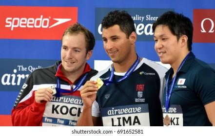 Hong Kong, China - Oct 30, 2016. Marco KOCH (GER), LIMA Felipe (BRA) and KOSEKI Yasuhiro (JPN) at the Victory Ceremony of the Men's Breaststroke 100m. FINA Swimming World Cup.