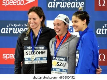 Hong Kong, China - Oct 30, 2016.  SEEBOHM Emily (AUS), Katinka HOSSZU (HUN) and ZEVINA Daryna (UKR) at the Victory Ceremony of  the Women's Backstroke 100m. FINA Swimming World Cup.