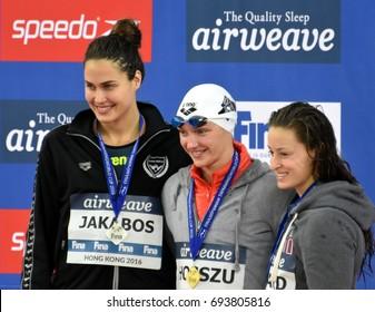 Hong Kong, China - Oct 30, 2016.  JAKABOS Zsuzsanna (HUN), HOSSZU Katinka (HUN) and SAVARD Katerine (CAN) at the Victory Ceremony of  the Women's Butterfly 200m. FINA Swimming World Cup.