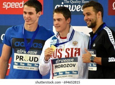 Hong Kong, China - Oct 30, 2016. PROUD Benjamin (GBR), MOROZOV Vladimir (RUS) and LE CLOS Chad (RSA) at the Victory Ceremony of Men`s Freestyle 50m. FINA Swimming World Cup.