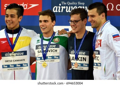 Hong Kong, China - Oct 30, 2016. ORTIZ-CANAVATE Miguel (ESP), SANKOVICH Pavel (BLR), LARKIN Mitch (AUS) and DONETC Stanislav (RUS) at the Victory Ceremony of Men`s Backstroke 50m. Swimming World Cup