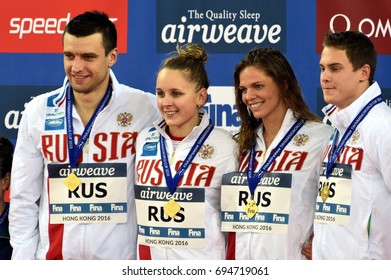 Hong Kong, China - Oct 30, 2016. Winner team Russia (MOROZOV Vladimir, DONETC Stanislav, USTINOVA Daria, EFIMOVA Yuliya) at the Victory Ceremony of  the Mixed Freestyle 4x50m. FINA Swimming World Cup