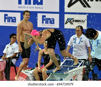 Hong Kong, China - Oct 30, 2016. World champion swimmer Yulia YEFIMOVA (RUS) at the start of the Mixed Freestyle 4x50m Final. MOROZOV Vladimir (RUS) in the background. FINA Swimming World Cup.