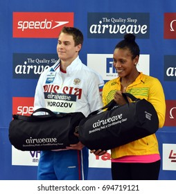 Hong Kong, China - Oct 30, 2016. Cluster winners MOROZOV Vladimir (RUS) and ATKINSON Alia (JAM) with gift bag. FINA Swimming World Cup
