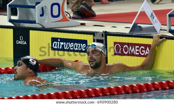 Hong Kong, China - Oct 30, 2016. Olympic and world champion LE CLOS Chad (RSA) and SHIOURA Shinri (JPN) after the Men's Butterfly 100m Final. FINA Swimming World Cup, Victoria Park Swimming Pool.