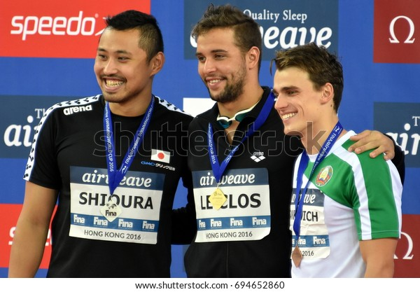 Hong Kong, China - Oct 30, 2016. SHIOURA Shinri (JPN), LE CLOS Chad (RSA) and SANKOVICH Pavel (BLR) at the Victory Ceremony of Men`s Butterfly 100m. FINA Swimming World Cup