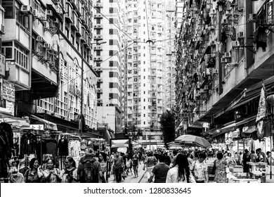 Hong Kong, China - October 13 2018: A large crowd walk in the Chun Yeung Street market in North Point in Hong Kong island through stall amid large apartment block.