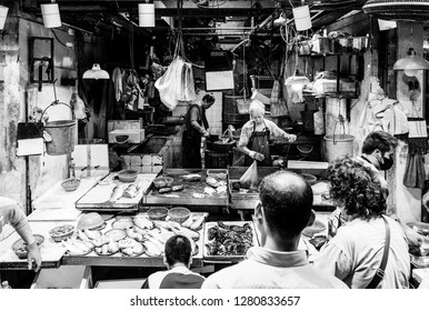 Hong Kong, China - October 13 2018: People buying seafood at the the Chun Yeung Street market in North Point in Hong Kong island. This is a traditional wet market.