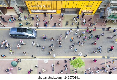 Hong Kong, China - October 19, 2013: Pedestrians walking on a street in Causeway Bay, Hong Kong. Causeway Bay is a major shopping district, and one of the most crowded area in Hong Kong